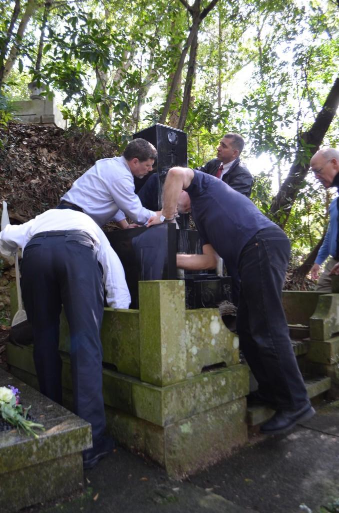 Birankai teachers clean Chiba Sensei's gravesite.